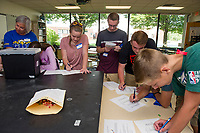 """Mrs. Bishop's freshman advisory class gets to know one another during the """"What Color Is My Personality"""" activity on Wednesday morning during Freshman Jump Start at Gilford High School.  (Karen Bobotas/for the Laconia Daily Sun)"""