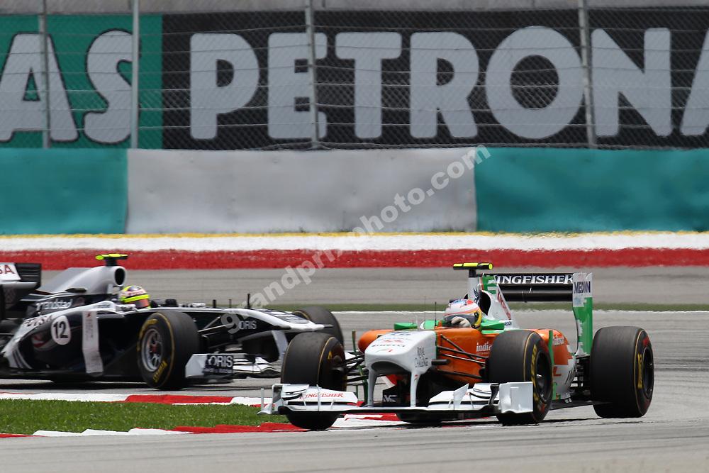 Paul di Resta (Force India-Mercedes) leads Pastor Maldonado (Williams-Cosworth) during practice for the 2011 Malaysian Grand Prix in Sepang outside Kuala Lumpur. Photo: Grand Prix Photo