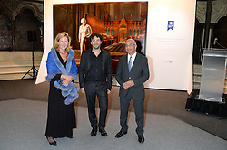 """Left to right, LADY PENNY MOUNTBATTEN, artist RALPH HEIMANS and RUMI VERJEE at a private view to view """"The Coronation Theatre: Portrait of Her Majesty Queen Elizabeth II"""" painted by Ralph Heimans held at Westminster Abbey, London on 12th September 2013."""
