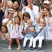 LONDON, ENGLAND - JULY 16: Roger Federer's wifeMirka Federerand theirfour children, identical twin daughtersMyla andCharlene, 7, and identical 3-year-old twinsonsLeoandLenny, cheer from the stands after the Gentlemen's Singles final won by Roger Federer during the Wimbledon Lawn Tennis Championships at the All England Lawn Tennis and Croquet Club at Wimbledon on July 16, 2017 in London, England. (Photo by Tim Clayton/Corbis via Getty Images)