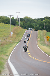 Steve Macdonald riding his 1928 Henderson Deluxe at the head of a group of Cannonballers during Stage 7 of the Motorcycle Cannonball Cross-Country Endurance Run, which on this day ran from Sedalia, MO to Junction City, KS., USA. Thursday, September 11, 2014.  Photography ©2014 Michael Lichter.