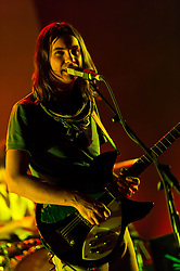 © Licensed to London News Pictures. 25/06/2013. London, UK.   Tame Impala performing live at Hammersmith Apollo. In this pic - Kevin Parker.  Tame Impala is a psychedelic rock band from Perth, Australia, composed of band members Kevin Parker (vocals, guitar), Dominic Simper (guitar/synth), Cam Avery (bass)  and Julien Barbagallo (drums).   Photo credit : Richard Isaac/LNP