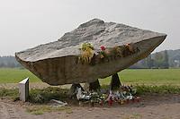 Pope John Paul II memorial in Blonia Park with Kosciuszko Mound behind in Krakow Poland