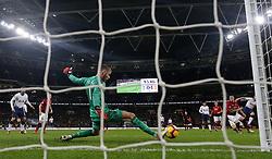 Manchester United goalkeeper David de Gea saves a shot from Tottenham Hotspur's Harry Kane