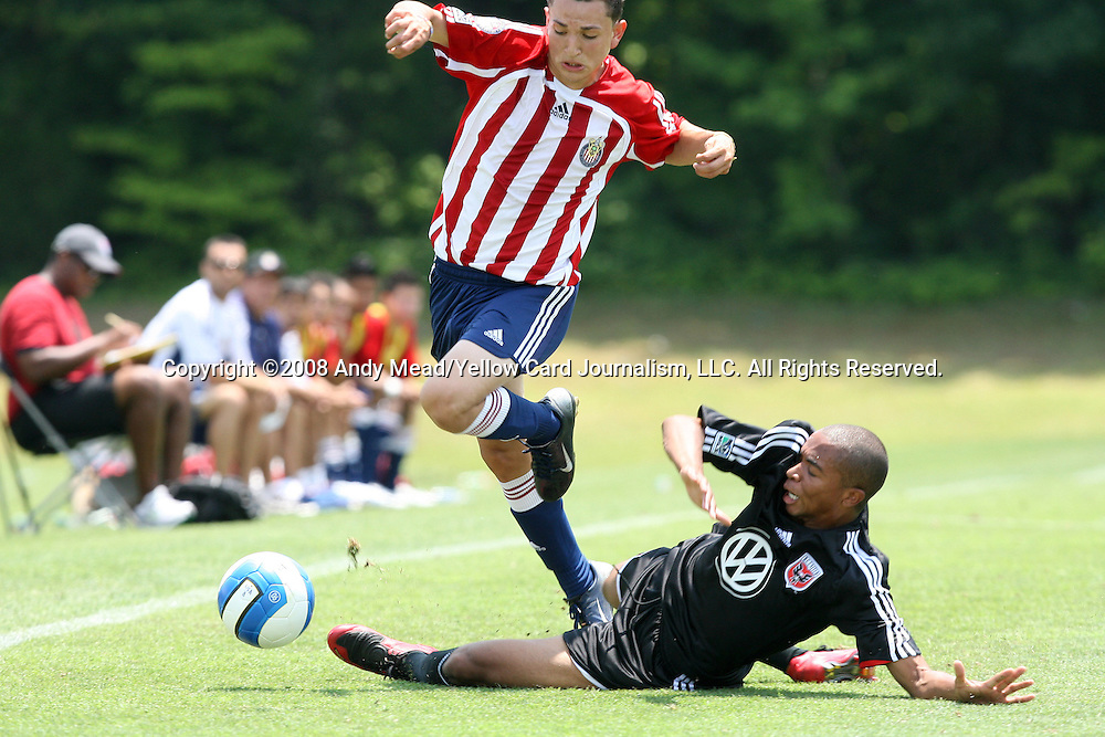 27 June 2008: Chivas's Mario Ledezma (l) avoids a slide tackle from DC's Howard Turk (r). The Chivas USA U18s defeated the DC United U18s 2-1 on Field 3 at Bryan Soccer Park in Brown's Summit, NC as part of the U.S. Soccer Federation Development Academy Summer Showcase which is part of the 2007-2008 regular season.