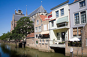 Canal waterside buildings near the Big Grote cathedral church, Dordrecht, Netherlands