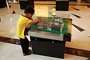 A young boy looks at models of apartment buildings at the sales office of the Huading Stars City in Yangzhou, Jiangsu Province, China on 19 July 2012. While the Chinese government has tried various ways to cool down the property market, real estate prices have still seen a steady increase in recent years, proving hard for the country to move away from an investment driven economy.