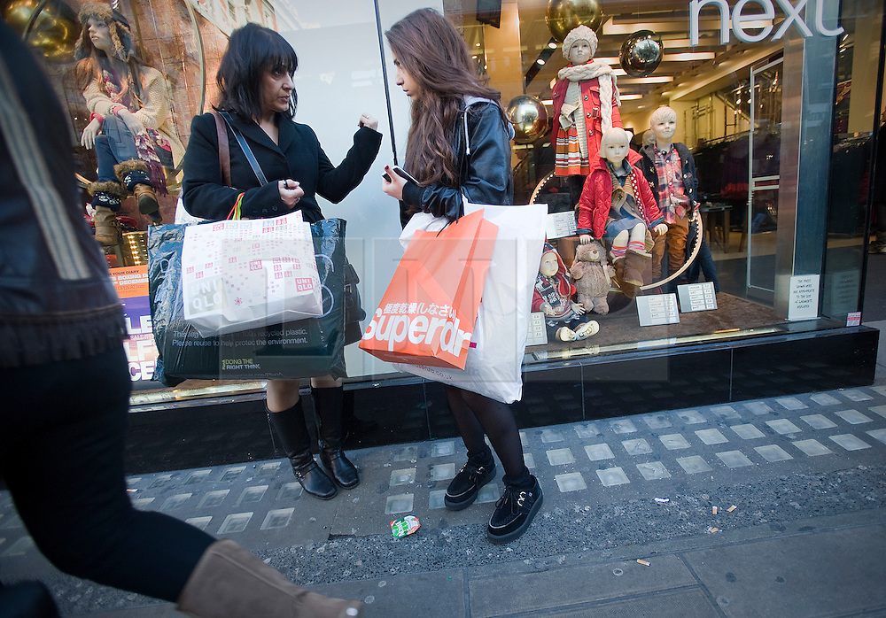 © Licensed to London News Pictures. 22/12/2011. London, UK. Shoppers on Oxford Street, London on December 22, 2011 . Tomorrow is expected to be the busiest shopping day of the year as the mad dash for last minute purchases begins.  Photo credit: Ben Cawthra/LNP