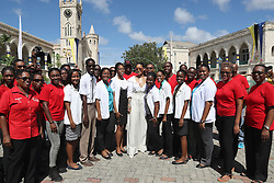 Rihanna poses with volunteers during the 'Man Aware' event held by the Barbados National HIV/AIDS Commission in Bridgetown, Barbados, during his tour of the Caribbean.