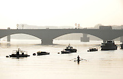 Putney. London. Tideway Week build up to the   2011 University Boat Race over parts of the Championship Course - Putney to Mortlake. General View, GV, Silhouette, sculler paddles away from Putney. Wednesday 23/03/2011  [Mandatory Credit; Karon Phillips/Intersport-images].. 2011 Tideway Week