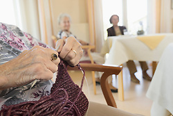 Senior Woman crocheting in rest home, Bavaria, Germany