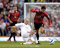 Fotball<br /> England 2005/2006<br /> Foto: SBI/Digitalsport<br /> NORWAY ONLY<br /> <br /> Manchester United v Debrecen VSC. UEFA Champions League Qualifier.<br /> 09/08/2005.<br /> <br /> Debreceni's Tamas Sandor (L) tries to get a tackle in on Manchester United's Cristiano Ronaldo