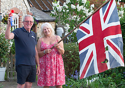 ©Licensed to London News Pictures 07/05/2020  <br /> Downe, UK. Mr & Mrs Langford from Downe in Kent waving the flag for the NHS at 8pm. <br /> Photo credit:Grant Falvey/LNP
