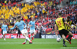 Manchester City's John Stones has a shot on goal during the FA Cup Final at Wembley Stadium, London.