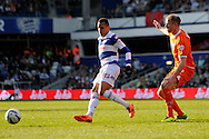 Queens Park Rangers Ravel Morrison passing the ball while Blackpool's Neil Bishop looks on. Skybet football league championship match , Queens Park Rangers v Blackpool at Loftus Road in London  on Saturday 29th March 2014.<br /> pic by John Fletcher, Andrew Orchard sports photography.