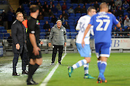 Cardiff City manager Neil Warnock (c) remonstrates with the assistant referee.  EFL Skybet championship match, Cardiff city v Sheffield Wednesday at the Cardiff city stadium in Cardiff, South Wales on Wednesday 19th October 2016.<br /> pic by Carl Robertson, Andrew Orchard sports photography.