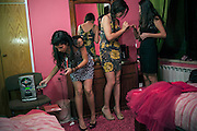 Ramallah, West Bank....high school students try on dresses for a school dance.