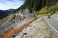 A vehicle travels down the Stevens Canyon road in Mount Rainier National Park, WA, USA