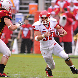 Sep 26, 2009; College Park, MD, USA; Rutgers running back Joe Martinek (38) jukes Maryland linebacker Alex Wujciak (33) during the first half of Rutgers' 34-13 victory over Maryland in NCAA college football at Byrd Stadium.
