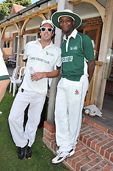 Left to right, NUMA HEATHCOTE and DAVE MARK at a cricket match to in aid of CARE - Corfu Animal Rescue Establishment held at Hawkley Cricket Club, Hawkley, Hampshire on 8th September 2012.