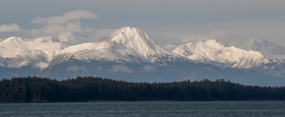 One November I was driving outside of Juneau, Alaska over lunch. As I headed out towards North Douglas I was awestruck by the mountains which appeared near Fritz Cove. Continuing down the road I waited until the island was in front of this peak and captured the image.