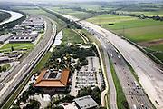 Nederland, Utrecht, Breukelen, 08-03-2002;  Hotel Breukelen (Van der Valk) in het midden, links de vernieuwde spoorlijn (4 sporen) van Amsterdam richting Utrecht met aftakking richting Woerden, rechts de autosnelweg A2;  naast de bestaande weg is zand opgespoten voor de nieuwe (en verbreedde) snelweg; file, automobiliteit, mobiliteitskruispunt,  infrastuctuur, verkeer en vervoer; luchtfoto (toeslag); aerial photo (additional fee required); .foto Siebe Swart / photo Siebe Swart