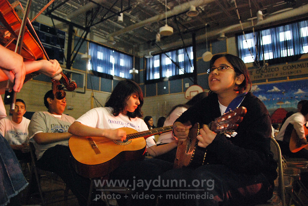 """USA, Chicago, June 4th, 2009.  Young """"mariachi"""" Ivette Espinoza is able to maintain a strong link to her Mexican cultural heritage through classes offered at several Pilsen schools.  Veteran musician Victor Pichardo, of the band """"Sonos de Mexico,"""" and his son Yahvi, a former CPS music teacher, began a pilot program in 2008 which enables students to build upon their skills year after year."""