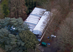 © Licensed to London News Pictures. 11/01/2021. Leatherhead, UK. A tented temporary mortuary facility has opened in the grounds of the former RAF rehabilitation hospital at Headley Court near Leatherhead in Surrey. Hospital mortuaries are at full capacity as the death rate from the covid-19 pandemic increases.Photo credit: Peter Macdiarmid/LNP