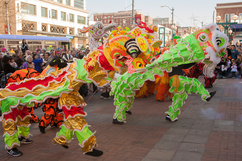 """United States, Washington, Seattle. Lion Dance, Chinese Lunar New Year celebration in Seattle's """"International District"""", traditional home of the city's Asian community."""