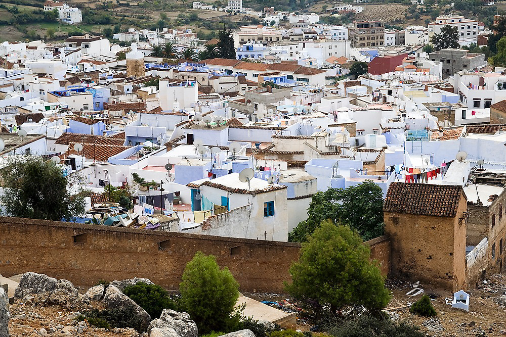 View of the rooftops of the colorful blue Chefchaouen medina, Morocco.