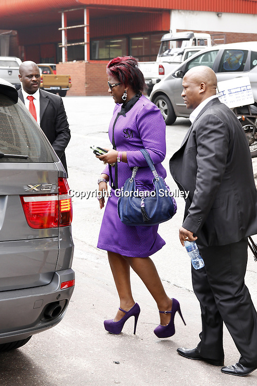 DURBAN - 19 September 2013 Durban businesswoman Shauwn Mpisane and her husband Sibusiso (right) leaves the Durban Commercial Crimes Court after the  State's bid to obtain a six week postponement was refused. Mpisane faces 53 charges of fraud, forgery and uttering of a forged document. Mpisane is accused of submitting forged documents to obtain Construction Industry Development Board (CIDB) gradings, which were then used to win five public works department tenders worth R140 million. Picture: Allied Picture Press/APP