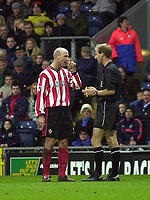 Photo. Glyn Thomas<br />Blackburn Rovers v Southampton. FA Barclaycard Premiership.<br />Ewood Park, Blackburn. 08-02-2003.<br />Southampton's Chris Marsden (L) disputes the yellow card he was awarded from referee Mike Riley