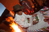 """A short walk from Collasuyo, Huasao has always been the village of shamans, faces also celebrates an annual festival of shamanismo, Doña Benita Mamani from the department of Ayacucho, plays a """"mesa"""" and blesses bystanders"""
