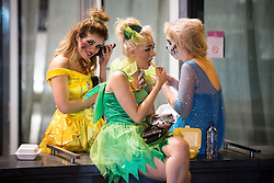 © Licensed to London News Pictures . 01/11/2015 . Manchester , UK . Three women eating takeaway food . Halloween revellers , wearing make up and costumes , out and about in Manchester City Centre . Photo credit : Joel Goodman/LNP