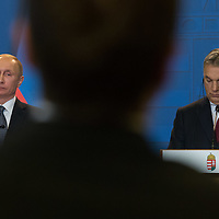 Russian journalist (C) asks questions from Vladimir Putin (L) president of Russia and Viktor Orban (R) prime minister of Hungary during a press conference in Budapest, Hungary on February 02, 2017. ATTILA VOLGYI