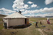 The son of Abdul Walli is fixing the center piece on the yurt, during the yearly migration to teh summer camp..Daily life at the Khan (chief) summer camp of Kara Jylga...Trekking through the high altitude plateau of the Little Pamir mountains (average 4200 meters) , where the Afghan Kyrgyz community live all year, on the borders of China, Tajikistan and Pakistan.