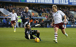 Millwall's David Forde dives at the feet of Burnley's Scott Arfield - Photo mandatory by-line: Robin White/JMP - Tel: Mobile: 07966 386802 02/11/2013 - SPORT - FOOTBALL - The Den - Millwall - Millwall v Burnley - Sky Bet Championship