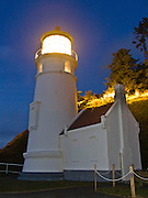 Heceta Head Lighthouse at sunset in winter, on the Oregon coast. Heceta Head Lighthouse may be the most photographed beacon in the United States. Built in 1893, it was named for the Spanish mariner who is credited with being the first European to set foot in the region. The light at top of 56-foot tower was first illuminated in 1894. Perched 205 feet above the ocean, its fresnel lens beams the brightest light on the Oregon coast, visible up to 21 miles out to sea.  Location: Halfway between Cape Perpetua and Florence, a turnoff just south of Carl Washburne State Park (which has a great campground) takes you to the parking lot on a beach, where you can walk a half mile to the lighthouse. Heceta Head State Park includes Devils Elbow State Park and is located in a scenic cove at the mouth of Cape Creek.