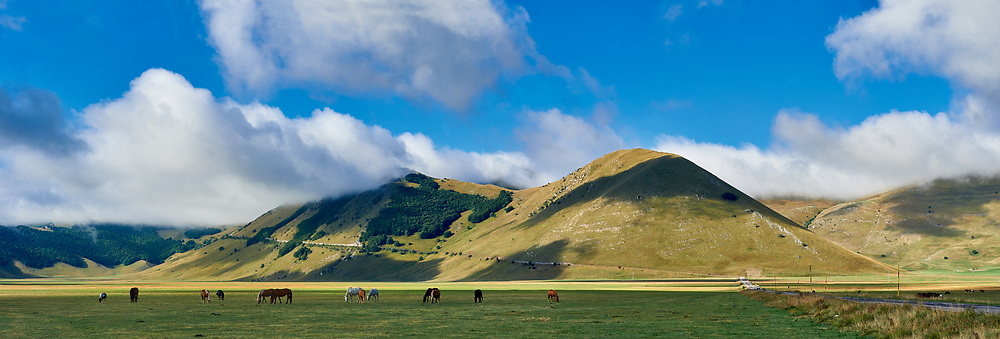 Piano Grande, Great Plain, of Castelluccio di Norcia, Parco Nazionale dei Monti Sibillini , Apennine Mountains,  Umbria, Italy. .<br /> <br /> Visit our ITALY HISTORIC PLACES PHOTO COLLECTION for more   photos of Italy to download or buy as prints https://funkystock.photoshelter.com/gallery-collection/2b-Pictures-Images-of-Italy-Photos-of-Italian-Historic-Landmark-Sites/C0000qxA2zGFjd_k