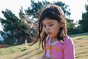 frightened young girl of 5 alone outdoors