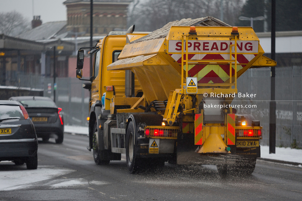A Lambeth council gritting lorry spreads grit over a minor road by Herne Hill station in south London during the bad weather covering every part of the UK and known as the 'Beast from the East' because Siberian winds and very low temperatures have blown across western Europe from Russia, on 1st March 2018, in Lambeth, London, England.
