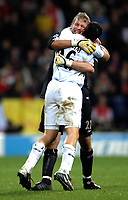 Photo: Paul Greenwood.<br />Bolton Wanderers v Arsenal. The FA Cup. 14/02/2007. The Bolton duo of Jussi Jaaskelainen Tal Ben Haim celebrate the equalising goal