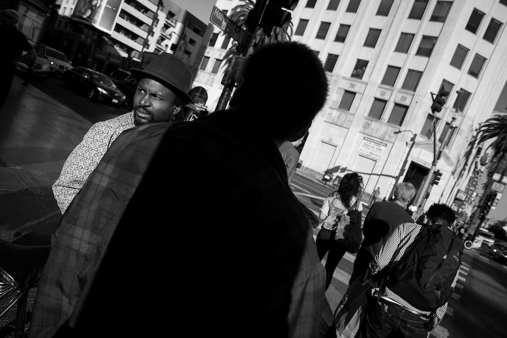 A man glances down Hollywood Boulevard in Hollywood, CA.