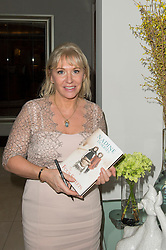 © Licensed to London News Pictures. 08/04/2014. London, UK. Nadine Dorries at the launch party of her first novel, The Four Sisiters. The party took place at the Intercontinental Hotel at Westminster. Photo credit : Simon Ford/LNP