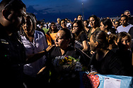 Dina Lizarde, center, is comforted by community members after attending a vigil for her son, Javier Rodriguez, 15, a sophomore at Horizon High School in Horizon, Texas, Monday, August 5, 2019. Rodriguez was the youngest victim among the 23 people murdered in the shooting at a Walmart on Aug. 3 in El Paso.