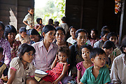 LAC lawyer Noun running a workshop in basic legal rights in Kork Chork. This is LAC's first visit to Kork Chork and they have invited local villagers to meet in what is usually only used as a temple.Legal Aid Cambodia  tries through out-reach education in schools to prevent children from falling into crime and teach them their rights.LAC also offer legal aid to children arrested and sent to prison, many of them without any legal representation.