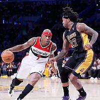21 March 2014: Washington Wizards forward Al Harrington (7) drives past Los Angeles Lakers forward Jordan Hill (27) during the Washington Wizards 117-107 victory over the Los Angeles Lakers at the Staples Center, Los Angeles, California, USA.