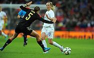 Toni Duggan of England Women is challenged by Annike Krahn of Germany Women<br /> - Womens International Football - England vs Germany - Wembley Stadium - London, England - 23rdNovember 2014  - Picture Robin Parker/Sportimage