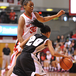 Feb 21, 2009; Piscataway, NJ, USA; Rutgers forward Brooklyn Pope (32) pressures Providence guard Lola Wells (20) during the first half of Rutgers' 55-42 victory over Providence at the Louis Brown Athletic Center.