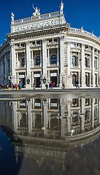 THEMENBILD - Burgtheater in Wien. Aktuell in den Medien wegen der Entlassung des Burgtheater Direktors Matthias Hartmann. Das Bild wurde am 11. Maerz 2014 aufgenommen. im Bild Burgtheater spiegelt sich in einer Pfuetze // THEMES PICTURE - Burgtheater in Vienna, currently in news because of finance affair about director of the Burgtheater. The image was taken on march, 11th, 2014. Picture shows Burgtheater with reflection in a puddle, AUT, EXPA Pictures © 2014, PhotoCredit: EXPA/ Michael Gruber